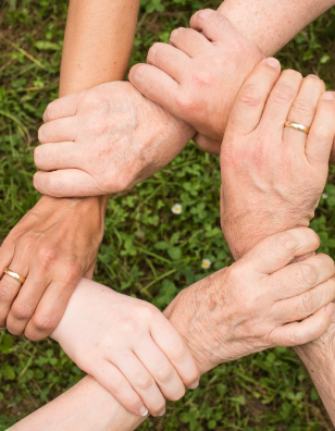 Photo of hands clasped together in support